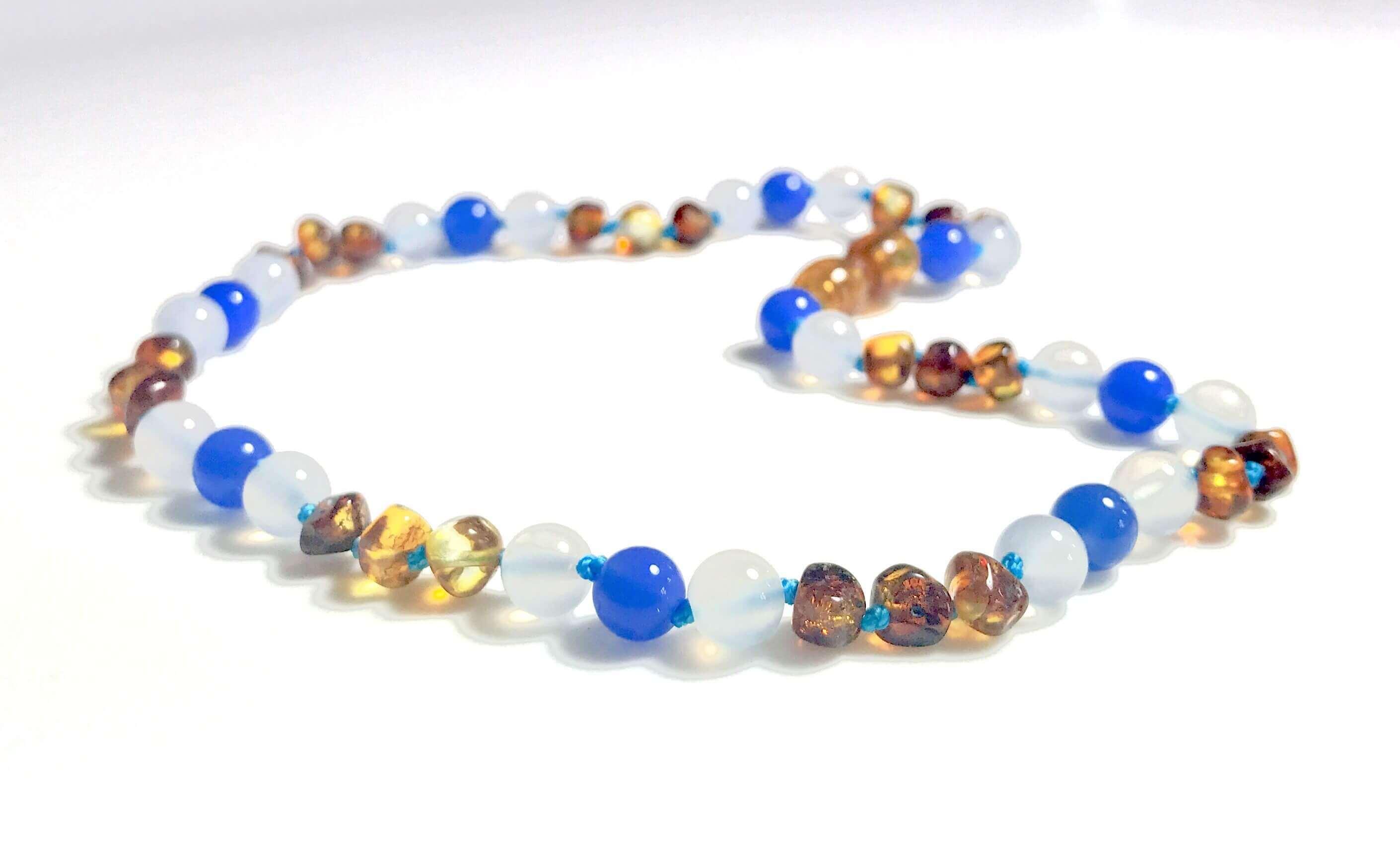 98c14920ed7 Nouveau collier d Ambre bébé couleur Caramel et Agate banche et bleue